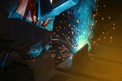 Welder at work for close-up work, joining parts with welding. Welder at work for close-up work, joining parts with welding Stock Images