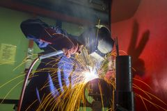 Welder at work. With fire blaze Royalty Free Stock Images