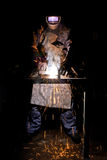 Welder at work and flying sparks.  Stock Photo