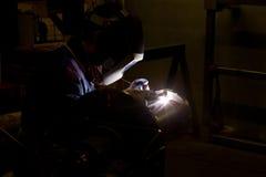 Welder at work in industrial surrondings. Stock Photo