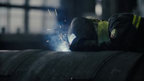 Welder at work in metal industry. Close up of welding. Manufacture of trucks. Worker welding metal stock footage