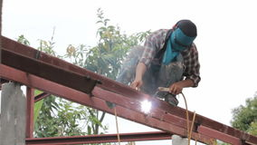 Welder at work on the roof. stock footage