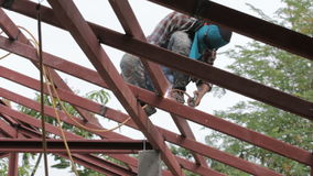 Welder at work on the roof. stock video footage