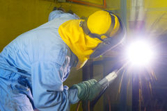 Welder at work. With safety clothing Stock Image