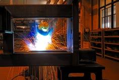 Welder at work. Welders welding large steel workpieces Royalty Free Stock Photography