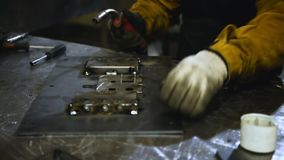 Welder at work. Worker welds metal parts. Welding process, sparks, flame, smoke. Plant for the production of various stock footage