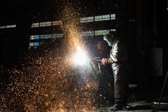 Welder at work. Welder working in a steel factory. The welding of the metal form spectacular trails of light Stock Photo