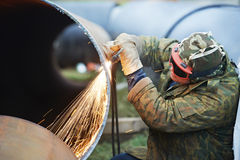 Welder worker with flame torch cutter Royalty Free Stock Image
