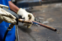 Welder worker heating copper pipe Royalty Free Stock Photo