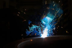 Welder worker is welding Royalty Free Stock Image