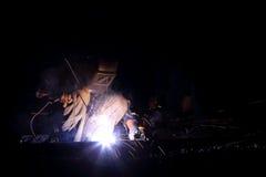 Welder worker welding metal construction. The welder worker welding metal construction Royalty Free Stock Photography