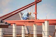 Welder workers installing steel frame structure Stock Photos