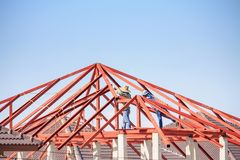 welder workers installing steel frame structure of the house Royalty Free Stock Photo