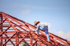 Welder workers installing steel frame structure of the house. Construction welder workers installing steel frame structure of the house roof at building royalty free stock photos
