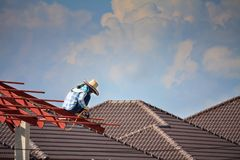 Welder workers installing steel frame structure of the house Royalty Free Stock Photos