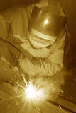 Welder working. A Man is weldind a big place of steel Stock Photo