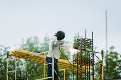 Welder working with electrode. Welder with the electrode at a construction site Royalty Free Stock Images
