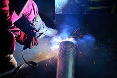 Welder working in factory Royalty Free Stock Photos