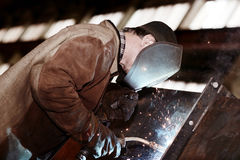 Welder working at  factory. Welder working at the factory Stock Photography