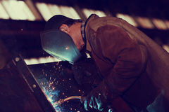 Welder working at factory. Welder working at the factory Stock Photo