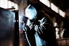 Welder working at  factory. Welder working at the factory Stock Images