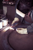 Welder working at the factory Stock Image