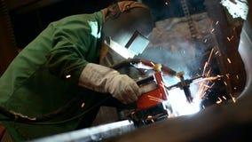 Welder working in factory stock video footage