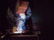 Welder working factory welding the metal Stock Image