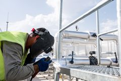 Welder Working At Heavy Industrial Construction Site. Outdoors Stock Photos