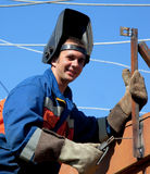 A welder working at height Royalty Free Stock Images