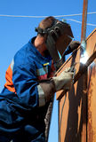 A welder working at height Royalty Free Stock Photography
