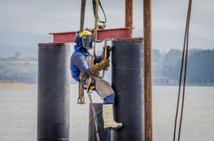 A welder is working on a high-rise building Royalty Free Stock Image
