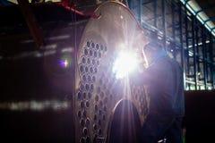 Welder working in industrial factory Stock Photo