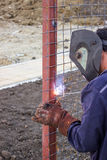 Welder working on installation a metal fence Royalty Free Stock Images