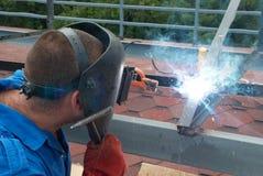 Welder working with metal construction. Welder at the factory working with metal construction Royalty Free Stock Image