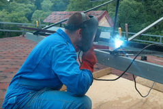 Welder working with metal construction Stock Photo