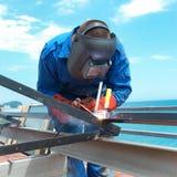 Welder working with metal construction Stock Image