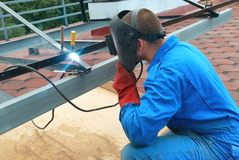 Welder working with metal construction. Man at work: welder worker on constructiion site  working with metal construction Stock Image