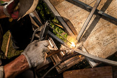 Welder working with metal construction outdoor. Welder working with metal construction close up Royalty Free Stock Images