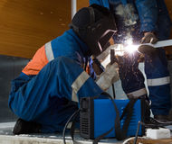 Welder working with a metal structure Stock Photography