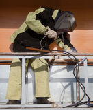 Welder working with a metal structure Stock Image