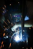 Welder working on motorcycle Stock Images
