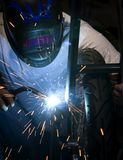 Welder working on motorcycle Stock Image