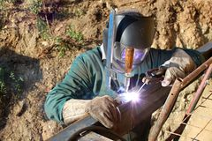 Welder working outside Stock Photo