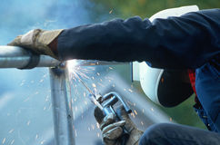 Welder working on pipe Stock Images