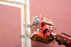 Welder working on a ship. Image of construction worker welding plate steel on a new ship Stock Images