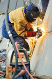 Welder working at shipyard in day time Stock Image
