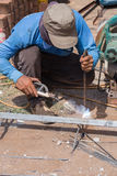 Welder working a welding metal. Not wearing glove Royalty Free Stock Image