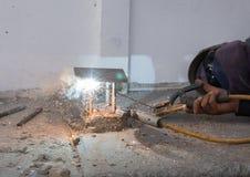 Welder working a welding metal. Not wearing glove Royalty Free Stock Photo