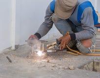 Welder working a welding metal. Not wearing glove Stock Images